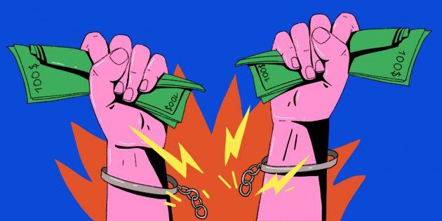 руки в наручниках с деньгами